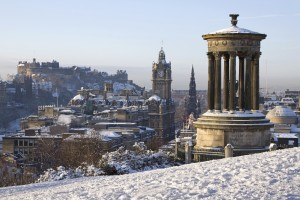 Edinburgh City and Castle viewed from Calton Hill on a beautiful winter morning with the Dugald Stewart monument in the foreground and the castle, Scott monument and Balmoral clock tower in the background.